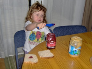 More jelly went into her mouth than on the bread.