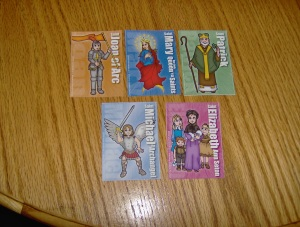 Saint Cards, given out at the end of each day
