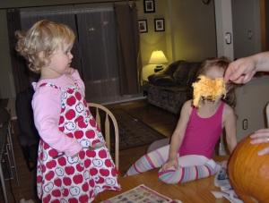 Hannah seeing the pumpkin guts